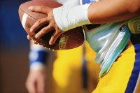 Close-up of Football Player Holding Football
